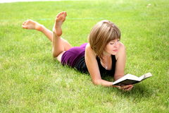 Young happy woman reading a book Royalty Free Stock Image