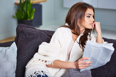 Young Happy Woman Reading Newspaper Royalty Free Stock Photos