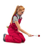 Young happy woman in red jumpsuit with painting tools royalty free stock photo