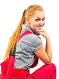 Young happy woman in red overalls Royalty Free Stock Photos