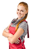 Young happy woman in red overalls Stock Image