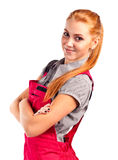 Young happy woman in red overalls Royalty Free Stock Image