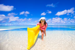 Young happy woman relaxing with air mattress Stock Image