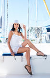 Young and happy woman relaxing on a boat Royalty Free Stock Images