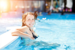 Young happy woman relaxing in swimming pool Stock Images