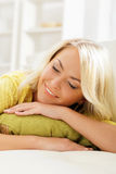 Young and happy woman resting on sofa at home Stock Images