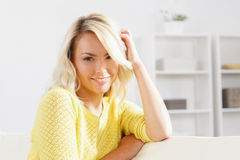 Young and happy woman resting on sofa at home.  stock photography