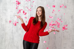 Young happy woman in rose petals Royalty Free Stock Images