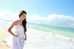 Young happy woman running on the beach Stock Photo