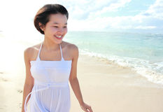 Young happy woman running on the beach Royalty Free Stock Image