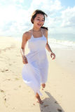 Young happy woman running on the beach Royalty Free Stock Photography
