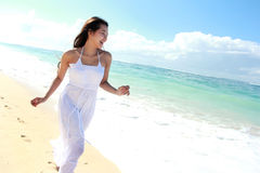 Young happy woman running on the beach Royalty Free Stock Photo