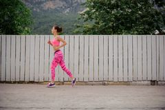 Young happy woman running to the new life in the morning. Ready to achieve a new goal.Conception of the healthy lifestyle royalty free stock images