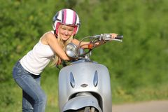 Young happy woman on scooter outdoor Royalty Free Stock Photo