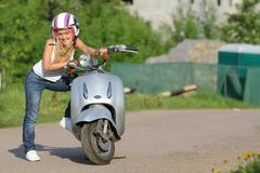 Young happy woman on scooter outdoor Stock Photography
