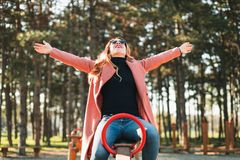 Young happy woman on the seesaw in the playground stock photo
