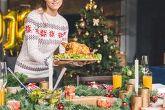 Woman serving christmas table with chicken Stock Image