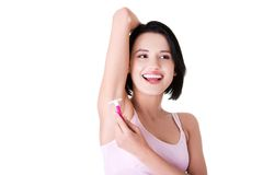 Young happy woman shaving armpit Royalty Free Stock Photos
