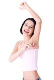 Young happy woman shaving armpit Royalty Free Stock Photos