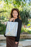 Young happy woman with shopping bag Royalty Free Stock Photography