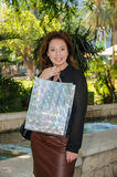 Young happy woman with shopping bag Royalty Free Stock Photos