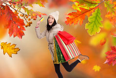 Young happy woman with shopping bags. Royalty Free Stock Photos