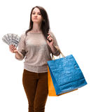 Young happy woman with shopping bags and  dollar cash money Royalty Free Stock Images