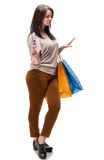 Young happy woman with shopping bags and  dollar cash money Royalty Free Stock Image