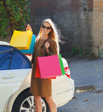 Young happy woman with shopping bags outdoors Stock Image