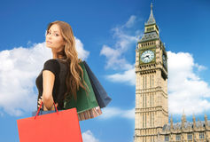 Young happy woman with shopping bags over big ben Stock Image