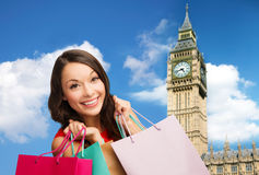 Young happy woman with shopping bags over big ben Stock Images