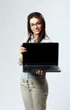 Young happy woman showing laptop Stock Photo