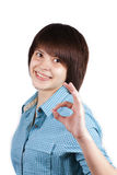 Young happy woman showing ok sign isolated Royalty Free Stock Image