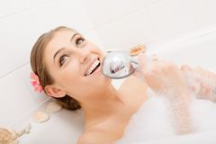Young happy woman singing in bath Royalty Free Stock Photos