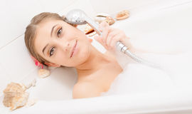 Young happy woman singing in bath Stock Photo