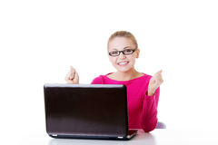 Young happy woman sitting in front of laptop. Stock Image