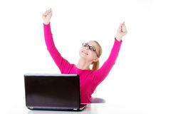 Young happy woman sitting in front of laptop. Stock Photography