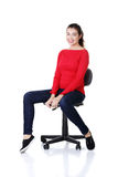Young happy woman sitting on a wheel chair Royalty Free Stock Images
