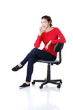 Young happy woman  sitting on a wheel chair Royalty Free Stock Photo