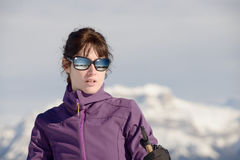 Young happy woman with ski poles at winter skiing Stock Photo