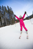 Young happy woman skier Stock Photo