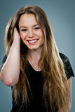 Young Happy Woman Smiling and Touching Her Hair Royalty Free Stock Photos