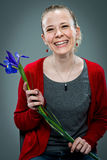 Young Happy Woman Smiling with a Violet Flower Stock Photos