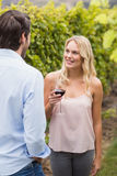 Young happy woman smiling at young man Stock Photography