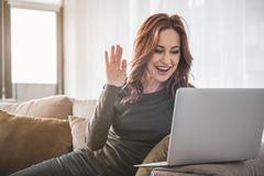 Young happy woman socializing online on her computer stock images