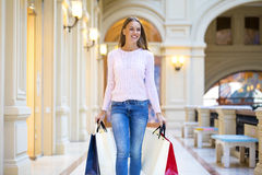 Young happy woman with some shopping bags in the mall Royalty Free Stock Image