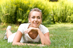 Young happy woman spends time in the park Royalty Free Stock Photo