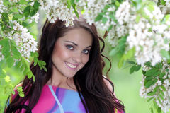 Young happy woman in spring or summer garden Royalty Free Stock Image