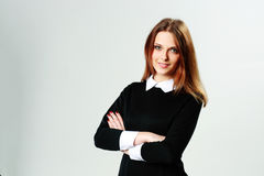Young happy woman standing with arms folded Royalty Free Stock Image