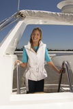 Young happy woman standing on boat stock image